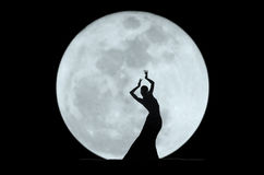 Graceful dancer silhouette. Chinese folk dancer performing on stage Stock Image