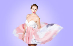 Graceful dreamy dancing girl in pink dress Stock Photography