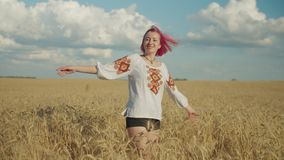 Graceful female having fun in golden wheat field stock video