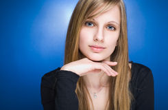 Graceful friendly young blond woman. Stock Photos