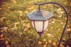 Graceful garden lantern with photocell Stock Photos