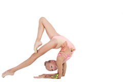 Graceful girl. The young graceful girl is engaged in gymnastics Royalty Free Stock Photography