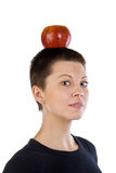 The graceful girl with an apple on a head. The graceful girl with an red apple on a head Royalty Free Stock Photos