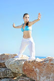 Graceful girl ashore epidemic deathes concerns with yoga Royalty Free Stock Image