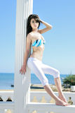 Graceful girl ashore epidemic deathes. Graceful one girl in blue swimsuit on sailboat Stock Photos