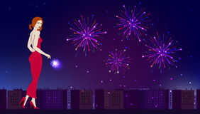Graceful girl on the background of an evening festive city. And fireworks Stock Image