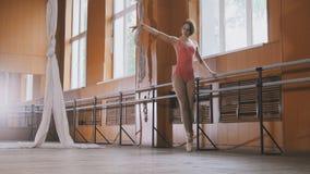 Graceful girl ballerina practicing in the Studio, elements of dance