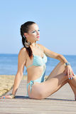 Graceful girl in blue swimsuit ashore epidemic deathes Stock Photo
