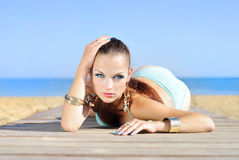 Graceful girl in blue swimsuit ashore epidemic deathes Stock Images