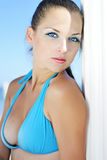 Graceful girl in blue swimsuit ashore epidemic deathes Stock Photography