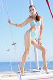 Graceful girl in blue swimsuit on sailboat Stock Photography