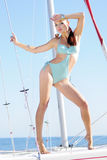 Graceful girl in blue swimsuit on sailboat Royalty Free Stock Images