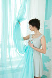 Graceful girl and curtain Royalty Free Stock Photo