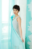 Graceful girl and curtain Royalty Free Stock Photography