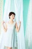 Graceful girl and curtain Royalty Free Stock Images