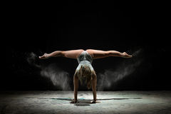 Graceful girl dancing in white dust color Royalty Free Stock Photography