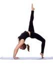 Graceful girl doing gymnastic bridge on mat Royalty Free Stock Photo