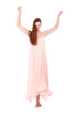Graceful girl in flying light pink dress Stock Photography