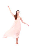 Graceful girl in flying light pink dress Royalty Free Stock Photos
