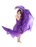 Graceful girl in flying purple silk dress Stock Image