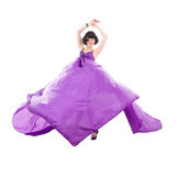 Graceful girl in flying purple silk fabric Stock Photo