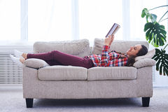 Graceful girl having rest while reading book Royalty Free Stock Photography