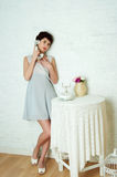 Graceful girl in a pastel interior Stock Photo