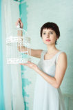 Graceful girl in a pastel interior Royalty Free Stock Photos