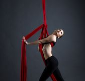 Graceful girl performs dance with hanging ribbons Stock Image