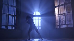 Graceful girl practicing ballet in studio, elements dance in moonlight stock video footage