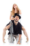 Graceful girl sits on papper back and tames his chain Stock Images