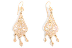 Graceful gold earrings Stock Image