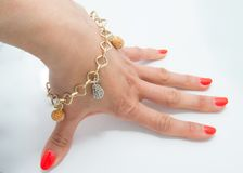 Graceful golden bracelet on woman hand Royalty Free Stock Images