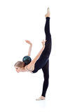 Graceful gymnast with ball on back stands on one leg Royalty Free Stock Photography