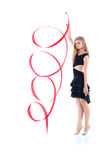 Graceful gymnast girl with ribbon stands on tiptoes Stock Photography
