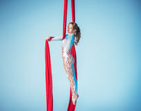 Graceful gymnast performing aerial exercise Stock Image
