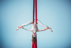 Graceful gymnast performing aerial exercise Stock Photography