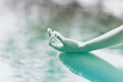 Graceful hand gesture of a woman meditating Royalty Free Stock Images