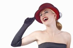Graceful lady with big smile. Holding her elegant red hat stock photography