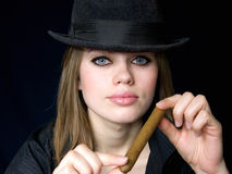 Graceful lady and cigar Royalty Free Stock Photography
