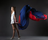 Graceful little athlete posing with colorful cloth Stock Photo