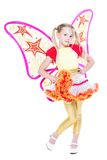 Graceful little blond girl. Posing in butterfly dress. Isolated on white Stock Photos