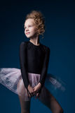 Graceful little dancer posing in studio Royalty Free Stock Images