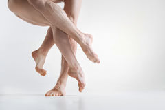 Graceful masterful dancers legs performing in the white colored room royalty free stock image