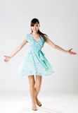 Graceful movement. Woman in aqua dress with hand spread out in a graceful dance movement Stock Image