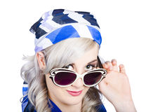 Graceful pin up girl looking over sunglasses Stock Images