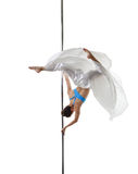 Graceful pole dancer posing in difficult turn Royalty Free Stock Photos