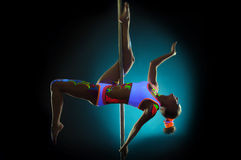 Graceful pole dancer with UV pattern on body Royalty Free Stock Photo