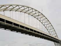 Graceful portion of steel archway traffic bridge Stock Photography