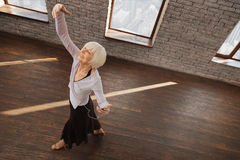 Graceful retired woman performing in the ballroom Royalty Free Stock Image